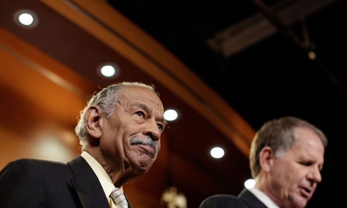 Rep. John Conyers (D-MI) (L) and Rep. Ted Poe (R-TX) (R) hold a news conference on H.R.1962, the 'Free Flow of Information Act of 2013', May 22, 2013 in Washington, DC. The bill would protect reporters from having to reveal their sources in federal court, with some exceptions including specific threats to national security. (Win McNamee/Getty Images)