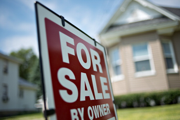 """A """"For Sale by Owner"""" sign stands outside a home in LaSalle, Ill., on June 7, 2013. (Daniel Acker/Bloomberg via Getty Images)"""