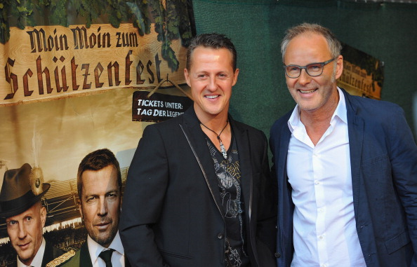 Michael Schumacher talks with television personality Reinhold Beckmann during the day of the legends event at the Millentor stadium on September 8, 2013 in Hamburg, Germany. (Photo by Stuart Franklin/Bongarts/Getty Images)