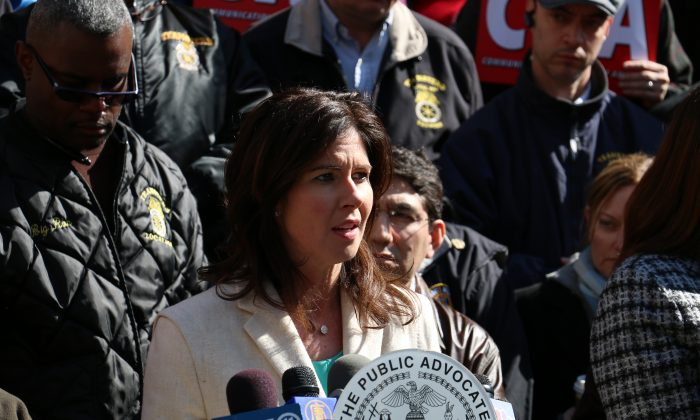 Councilwoman Elizabeth Crowley speaks at a rally calling for UPS to reverse its decision to fire 250 employees, April 3, 2014. (Allen Xie)