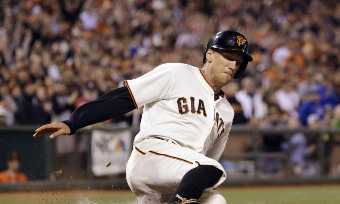 San Francisco Giants' Hunter Pence scores on single by Buster Posey during the third inning of a baseball game against the Los Angles Dodgers on Wednesday, April 16, 2014, in San Francisco. (AP Photo/Marcio Jose Sanchez)