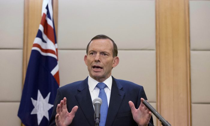 Former Australian Prime Minister Tony Abbott speaks during a press conference at a hotel in Beijing, China, on April 12, 2014. (AP Photo/Andy Wong)