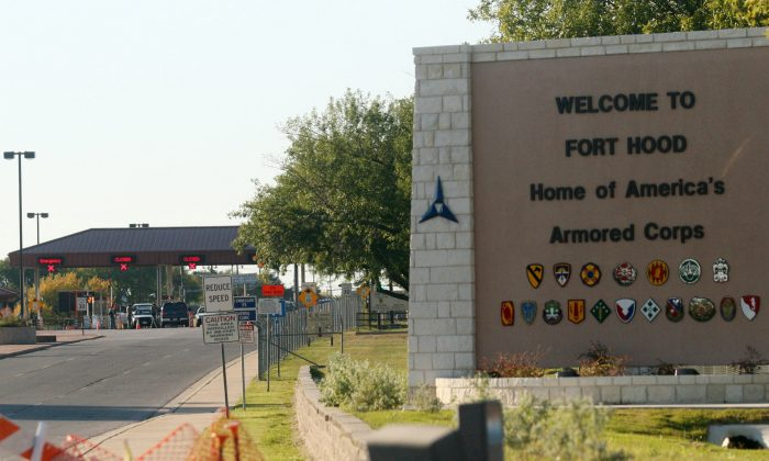 File photo, an entrance is shown to Fort Hood Army Base in Fort Hood, Texas. Fort Hood says there's been a shooting at the Texas Army base and that there have been injuries, on Wednesday, April 2, 2014. (AP Photo/Jack Plunkett)
