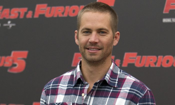 "In this April 29, 2011 file photo, actor Paul Walker poses during the photo call of the movie ""Fast and Furious 5,"" in Rome. (AP Photo/Andrew Medichini, File)"