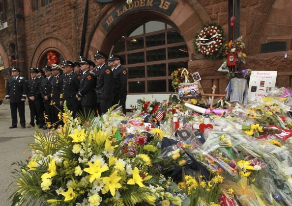 BOSTON - APRIL 2: People pay their respects to the two fallen firefighters who lost their lives battling a nine alarm fire last week on April 2, 2014. (Photo by Essdras M Suarez/The Boston Globe via Getty Images)