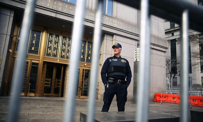A security officer stands outside of U.S. Federal Court House on the morning the court begins jury selection for the Abu Hamza terrorism trial on April 14, 2014 in New York City. Hamza, a disabled Egyptian Islamic preacher who was extradited from Britain following charges he conspired to support al-Qaida, is being charged for trying to create a terrorist training camp in Oregon 15 years ago. (Spencer Platt/Getty Images)