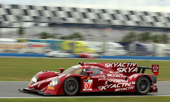 Tristan Nunez drives the #07 Mazda Skyactiv diesel P2 Prototype at the Roar Before the Daytona 24. The car was consistently slower than the competition, and suffered driveline woes. (Chris Jasurek/Epoch Times)