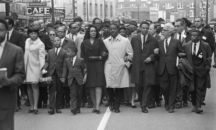 """Coretta Scott King (5th-R) leads a """"March on Memphis"""" 9 April 1968, five days after the assassination of her husband, US clergyman and civil rights leader Martin Luther King. On her right, her daughter, Yolanda, walks with her sons Martin and Dexter; on her left appear King's successor, the Rev. Ralph Abernathy, and Andrew Young, later U.S. President Jimmy Carter's ambassador to the United Nations and mayor of Atlanta. Martin Luther King was assassinated 4 April 1968 in Memphis, Tennessee. James Earl Ray confessed to the shooting. (AFP/AFP/Getty Images)"""