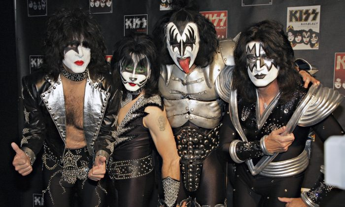 FILE - In this May 8, 2008 file photo, members of Kiss, from left, Paul Stanley, Eric Singer, Gene Simmons and Tommy Thayer, poses for a photograph during a news conference to promote the start of their KISS Alive/35 European Tour  in Oberhausen, Germany. (AP Photo/Volker Wiciok, file)