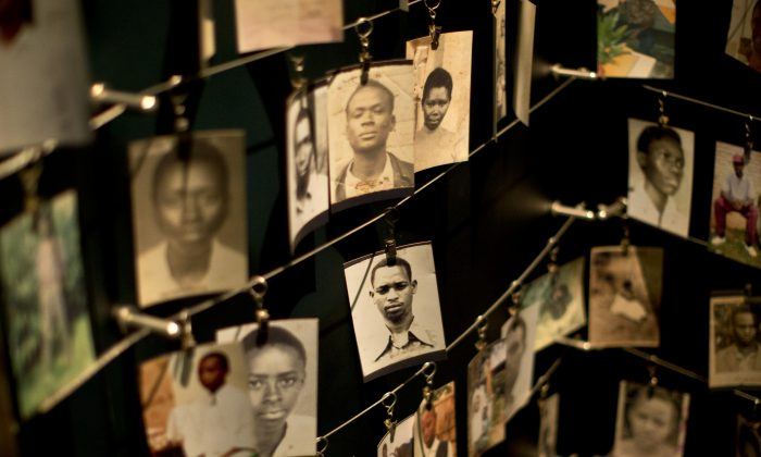 Rwanda Genocide Anniversary: Family photographs of some of those who died hang in a display in the Kigali Genocide Memorial Centre in Kigali, Rwanda on April 5, 2014.  (AP Photo/Ben Curtis)