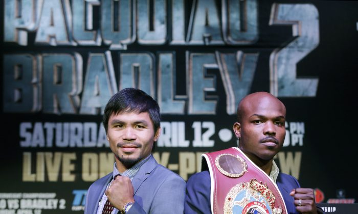 Boxer Manny Pacquiao, of the Philippines, left, poses for a photo with current WBO World Welterweight champion Timothy Bradley of Indio, Calif., during a press conference Thursday, Feb. 6, 2014, in New York. The pair will face off in a title fight in Las Vegas, April 12, 2014. (AP Photo/Kathy Willens)