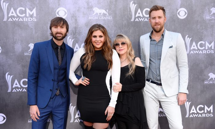 Stevie Nicks, second from right, and from left, Dave Haywood, Hillary Scott and Charles Kelley, of the musical group Lady Antebellum, arrive at the 49th annual Academy of Country Music Awards at the MGM Grand Garden Arena in Las Vegas on April 6, 2014. (Al Powers/Powers Imagery/Invision/AP)