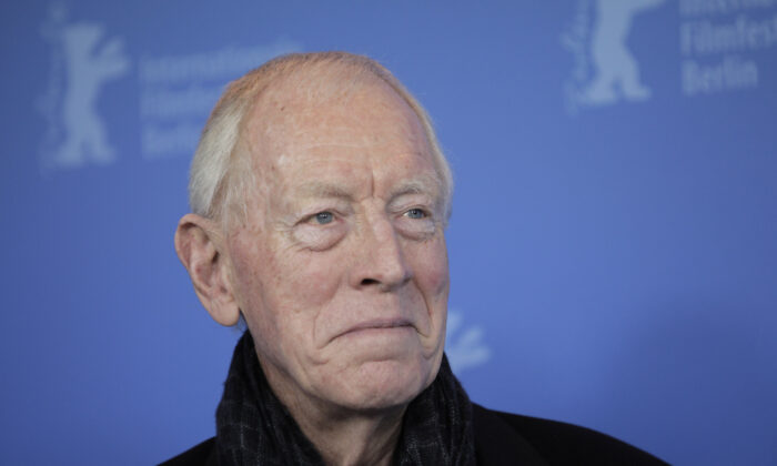 Actor Max von Sydow poses at the photo call for the film Extremely Loud and Incredibly Close during the 62 edition of International Film Festival Berlinale, in Berlin on Feb. 10, 2012. (Gero Breloer/AP Photo)