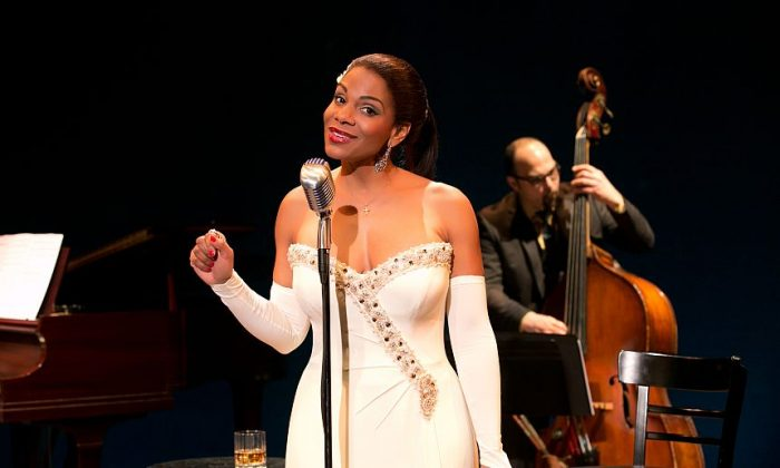 illie Holiday (Audra McDonald) with a member of the band, George Farmer on bass, behind her. (Evgenia Eliseeva)