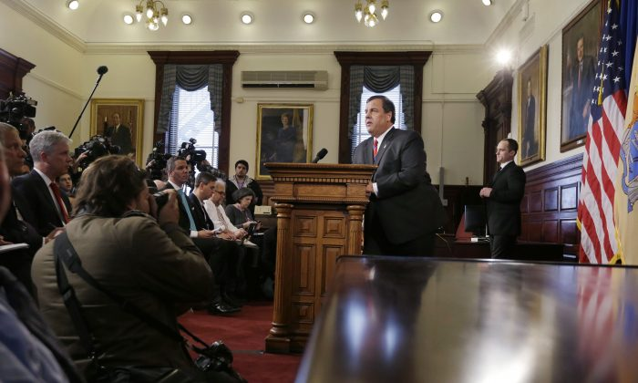 New Jersey Gov. Chris Christie listens to a question March 28 in Trenton, N.J,. about the lane closures near the George Washington Bridge. (Mel Evans/AP)