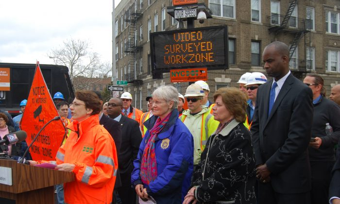 New York City Transportation Commissioner Polly Trottenberg announces new technology to further work zone safety in the city with officials and representatives from unions and utilities companies at a work site next to Sunset Park in Brooklyn, New York, April 8, 2014. (Catherine Yang/Epoch Times)
