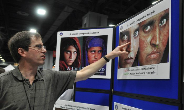National Geographic sought to find the little Afghan girl in an iconic photo 17 years after the photo was taken. They sought the help of the FBI in positively identifying which of the women who claimed to be the little girl really was the little girl, as explained at the CIA booth at the annual USA Science & Engineering Festival in Washington, D.C., on April 26, 2014. (Tara MacIsaac/Epoch Times)