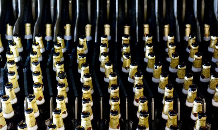 Bottles stand in row at the bottling facility of the Radeberger Export Beer Brewery in Radeberg, Germany, Nov. 19, 2013 (AP Photo/dpa, Sebastian Kahnert,File)