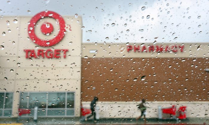 Shoppers leave a Target store on a rainy afternoon in Alhambra, Calif., Dec. 19, 2013. (FREDERIC J. BROWN/AFP/Getty Images)
