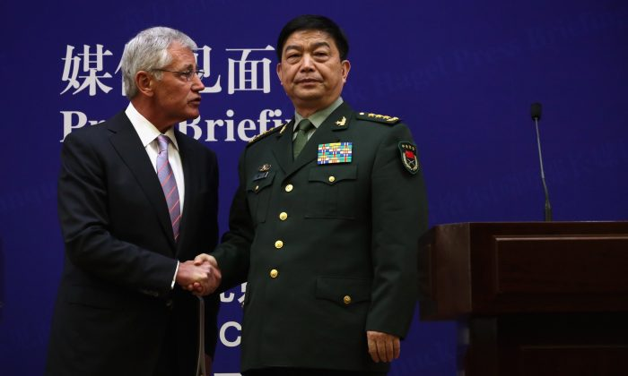 U.S. Secretary of Defense Chuck Hagel (L) and Chinese Minister of Defense Chang Wanquan (R) shake hands on April 8 in Beijing, China. The United States is asking China for more transparency on cybersecurity. (Alex Wong/Getty Images)