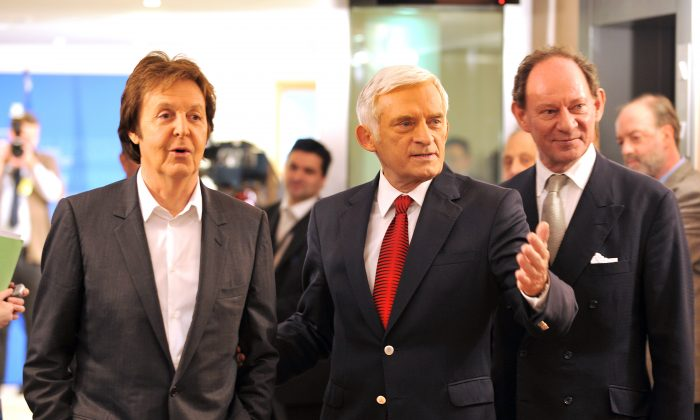 European Parliament Vice President Edward McMillan-Scott (R) and European Parliament President Jerzy Buzek (C) welcome British pop star Paul McCartney at the European Parliament in Brussels on Dec. 3, 2009. (Georges Gobet/AFP/Getty Images)