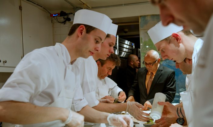 """James Beard Award-winning chef Daniel Boulud and his team plating for service during the """"Dinner with Daniel"""" event held at the James Beard House on Monday, March 31, 2014. (Courtesy of Ken Goodman)"""