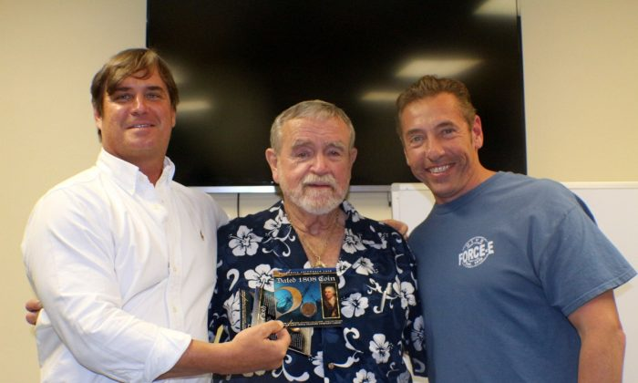 Captain Brad Williamson, Carl Fismer and winner of a shipwreck coin drawn from free raffle tickets at Force-E. Free prizes and drawings offer incentives for divers to attend lectures and programs. (Myriam Moran copyright 2014)
