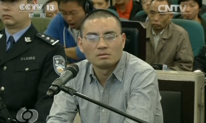 A microblogger who goes by the name of Qin Huohuo online plead guilty to all charges at trial on April 11, 2014, in Beijing. He was accused of using the Internet to spread rumors. (Screenshot/CCTV)