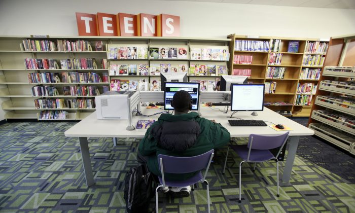 A boy uses a computer in the East Elmhurst public library branch in the Queens borough of New York, on Oct. 19, 2009. (AP Photo/Mary Altaffer)