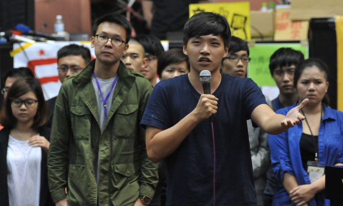 Student protest leader Chen Wei-ting (R) speaks during a protest against a contentious trade agreement with China inside the Legislative Yuan in Taipei on April 7, 2014. Taiwanese protesters said they would leave on April 10. (Mandy Cheng/AFP/Getty Images)