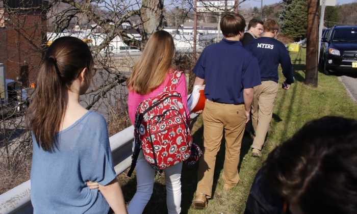 Students leave the campus of the Franklin Regional School District where several people were stabbed at Franklin Regional High School on Wednesday, April 9, 2014, in Murrysville, Pa., near Pittsburgh. The suspect, a male student, was taken into custody and being questioned. (AP Photo/Gene Puskar)