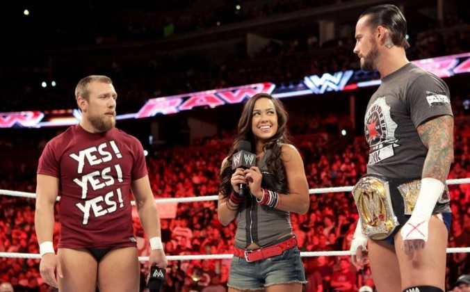 AJ Lee, middle, and CM Punk, right, in a file photo. (WWE)