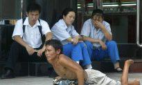 Chinese Gangs Said to Break Limbs to Make Children Beg
