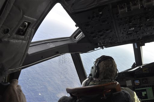 In this, Tuesday, April 1, 2014 photo made available Thursday, April 3, 2014, a crewman on a Royal New Zealand Air Force P-3 Orion Rescue Flight 795 searches for debris from the missing Malaysia Airlines Flight MH370, in southern Indian Ocean, 1,500 kilometers northwest of Perth, Australia. The focus of the search has changed repeatedly in the nearly four weeks since the air traffic controllers lost contact with the Boeing 777 between Malaysia and Vietnam over the South China Sea. It began in the South China Sea, then shifted toward the Malacca Strait to the west, where Malaysian officials eventually confirmed that military radar had detected the plane. (AP Photo/AAP Image, Kim Christian, POOL)