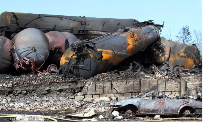 Transport Minister Lisa Raitt brought in tough new regulations on April 23, 2014 that require DOT-111 tank cars, like those pictured above at Lac-Mégantic, Quebec, after a fatal derailment, be upgraded or taken off the tracks. (The Canadian Press/Surete du Quebec)