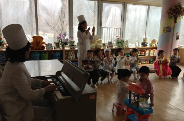 Children play at a daycare center in Pyongyang, where despite widespread poverty and a deeply militarized economy, many children enjoy better healthcare and childcare than children in wealthier Asian countries. But without a peace treaty to end the Korean War, the peninsula remains plagued by militarization and underdevelopment. (Christine Ahn)