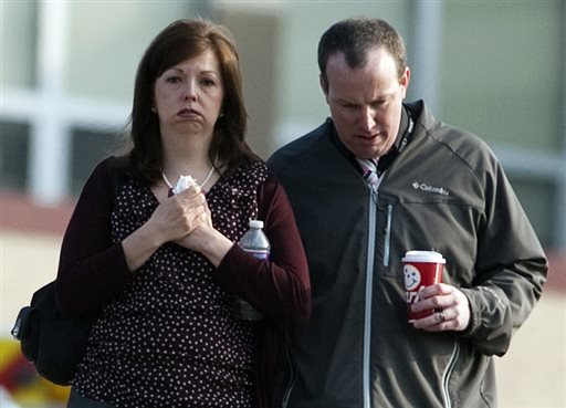 A man and woman walk away from Franklin Regional High School after more then a dozen students were stabbed by a knife wielding suspect at the school on Wednesday, April 9, 2014, in Murrysville, Pa., near Pittsburgh. The suspect, a male student, was taken into custody and is being questioned. (AP Photo/Tribune Review, Brian F. Henry)
