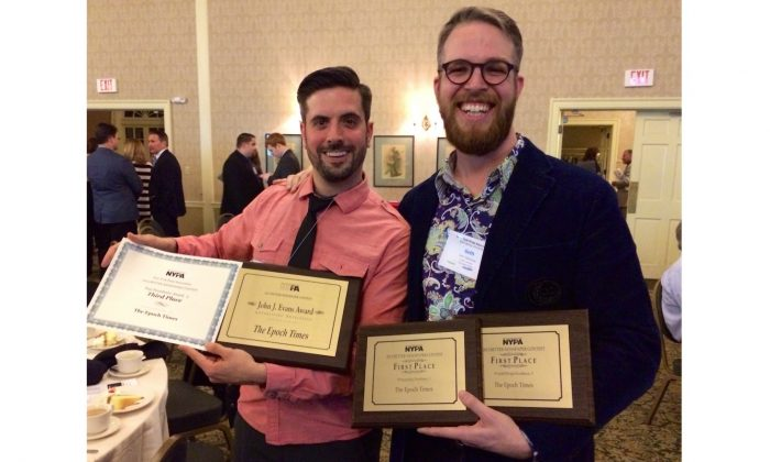 Epoch Times Creative Director Seth Holehouse and Associate Creative Director Robert Counts hold awards for overall excellence in photography, design, and advertising at the New York Press Association's annual conference in Saratoga Springs, N.Y., Saturday. (Epoch Times)