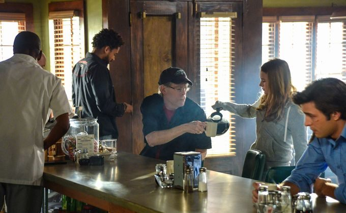 Angie McAlister (Britt Robertson) waits on 'Under the Dome' author Stephen King, who makes a cameo in the second season's first episode, which he wrote. Phil Bushey (Nicholas Strong) stands behind King, with Junior Rennie (Alexander Koch) to the right. (Brownie Harris/CBS)