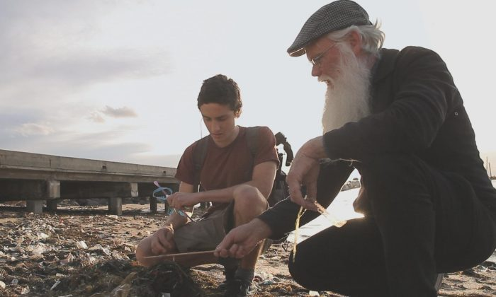 A still from Michael Lutman's documentary 'Baykeepers', showing Gio Fitzpatrick of the St Kilda EcoCentre and Neil Blake of the Port Phillip EcoCentre examining plastic litter on St Kilda Beach, in Melbourne, Australia. (Michael J. Lutman)