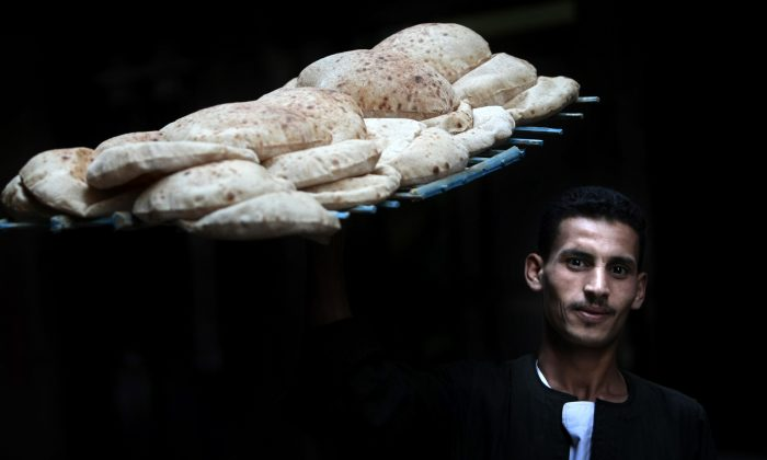 An Egyptian worker carries bread in a bakery in Cairo on October 22, 2011. (Mahmud Hams/AFP/Getty Images)