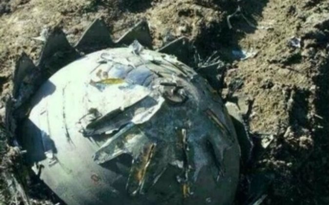 One of eight objects that fell from the sky in northeastern China May 16 and 17, 2014. (Network Screenshot)