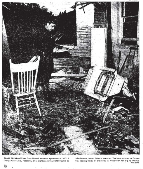 """Pasadena Police Department officer Ernie Howard at the scene of the explosion that killed John Whiteside """"Jack"""" Parsons. (Los Angeles Times)"""