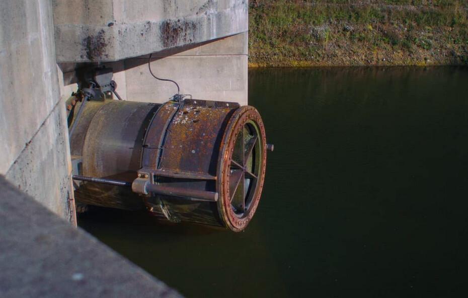 a dam's sluice gate in Night Moves