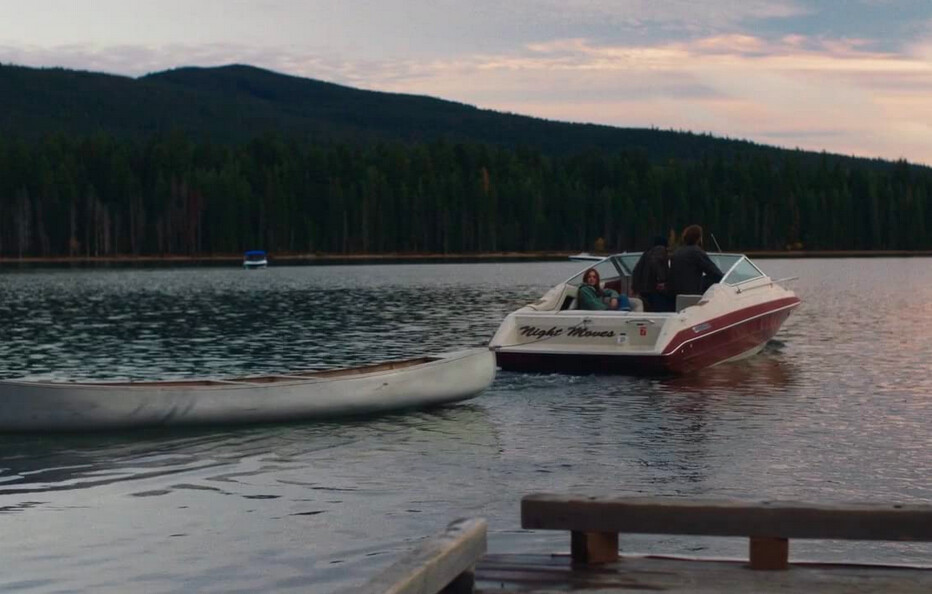 two men and a woman in a boat in Night Moves