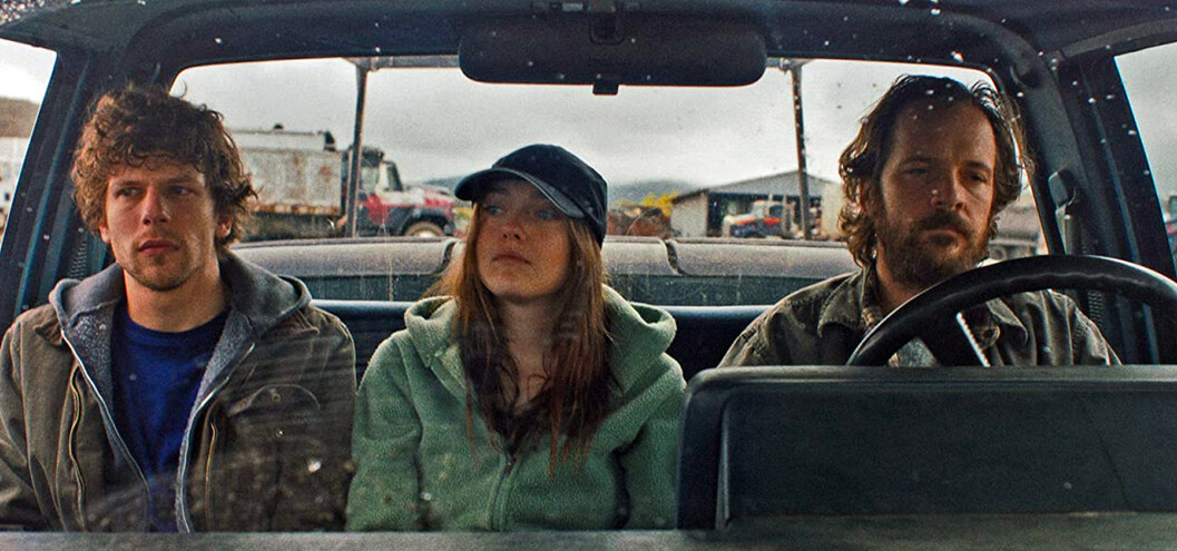 two men and a woman in a truck in Night Moves