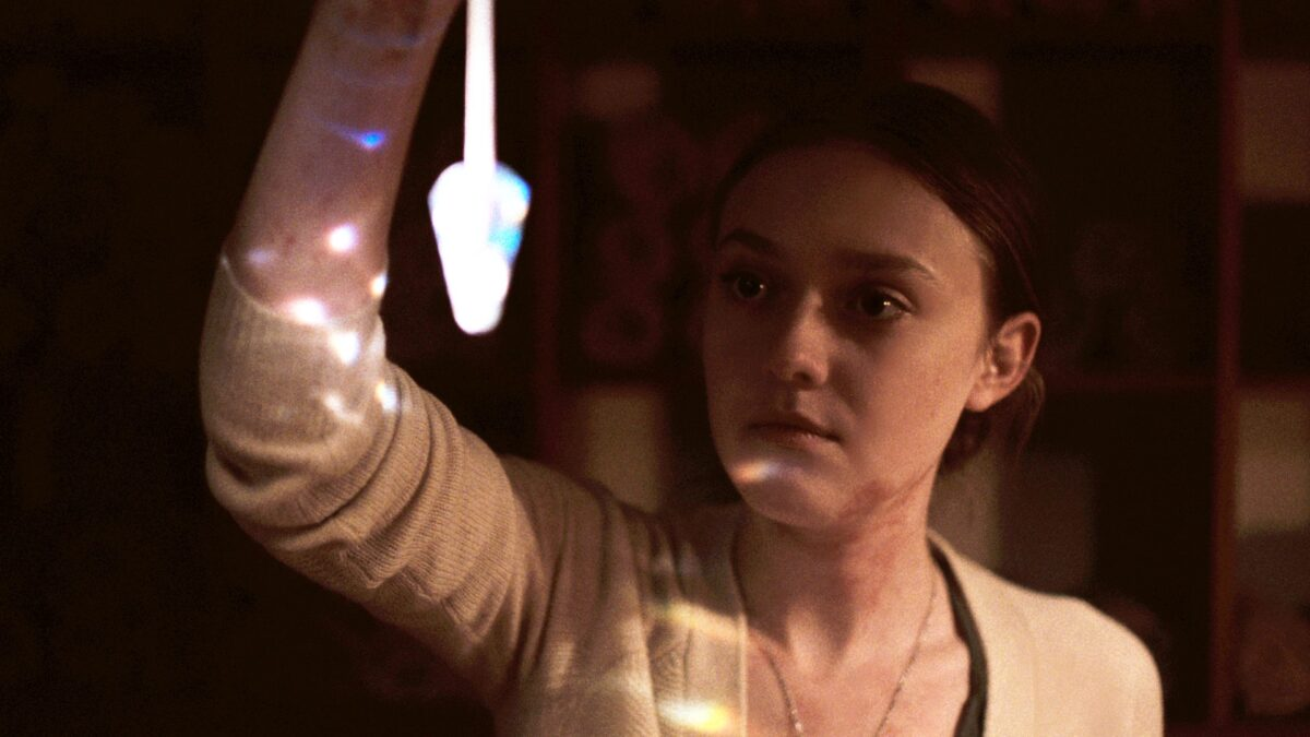 woman holds crystal in Night Moves