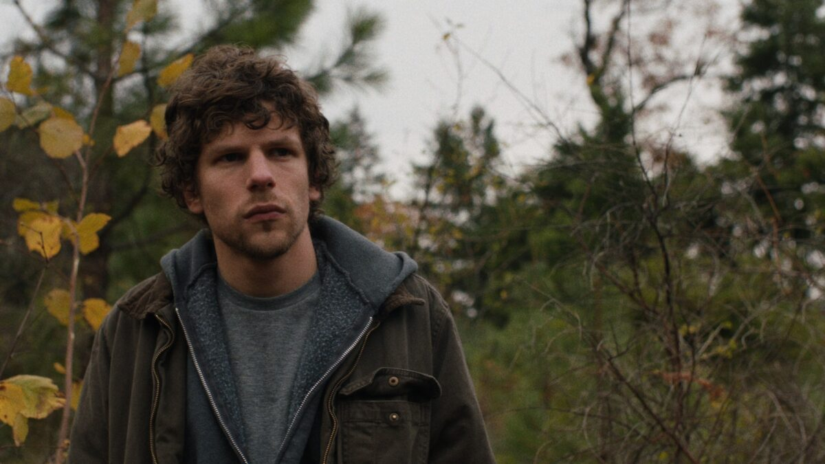 man with jacket in the woods in Night Moves