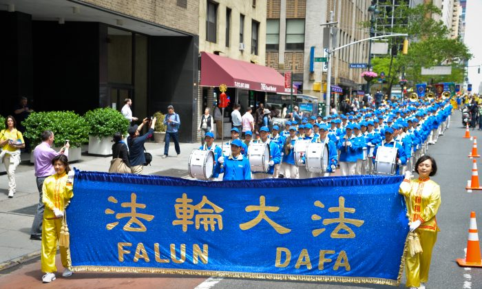 Practitioners of Falun Gong, participate in a parade in Manhattan on Wednesday. About 8,000 practitioners from around the world came to New York to celebrate World Falun Dafa Day to bring awareness to the spiritual practice and to the persecution of Falun Gong in China. (Dai Bing/Epoch Times)