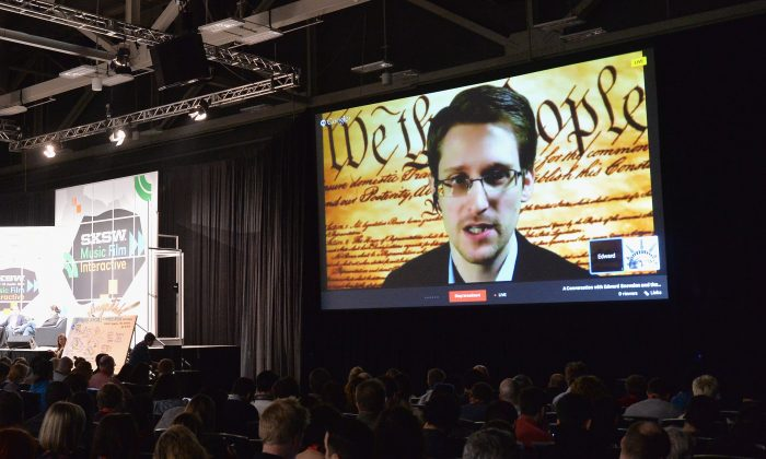 Edward Snowden, a former National Security Agency (NSA) contractor, speaks via videoconference during the 2014 SXSW Music Festival in Austin, Texas, last March. Hacking against American companies has increased fivefold since Snowden's leaks last year. (AP Photo/NBC News)